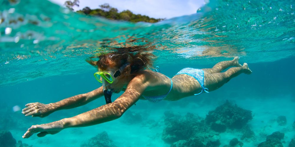 http://www.anchor.iflexiopensite.com/wp-content/uploads/demo/imagens/2014/03/bigstock-Young-lady-snorkeling-in-a-cle.jpg